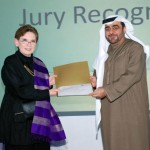 Magda Abu-Fadil receives PAMQA recognition from HBMEU Chancellor Mansour El Awar in Dubai.