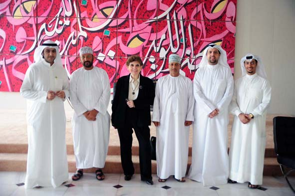 Media Unlimited director Magda Abu-Fadil flanked by trainees in Kuwait