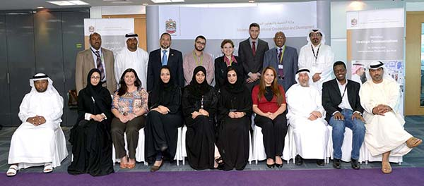 Magda Abu-Fadil (center back row) trains UAE-based foreign aid communications  officials