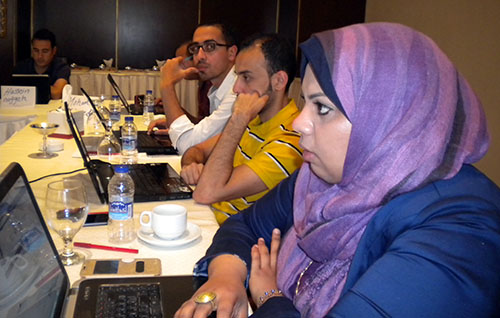 Egyptian journalists listen to comments about their work